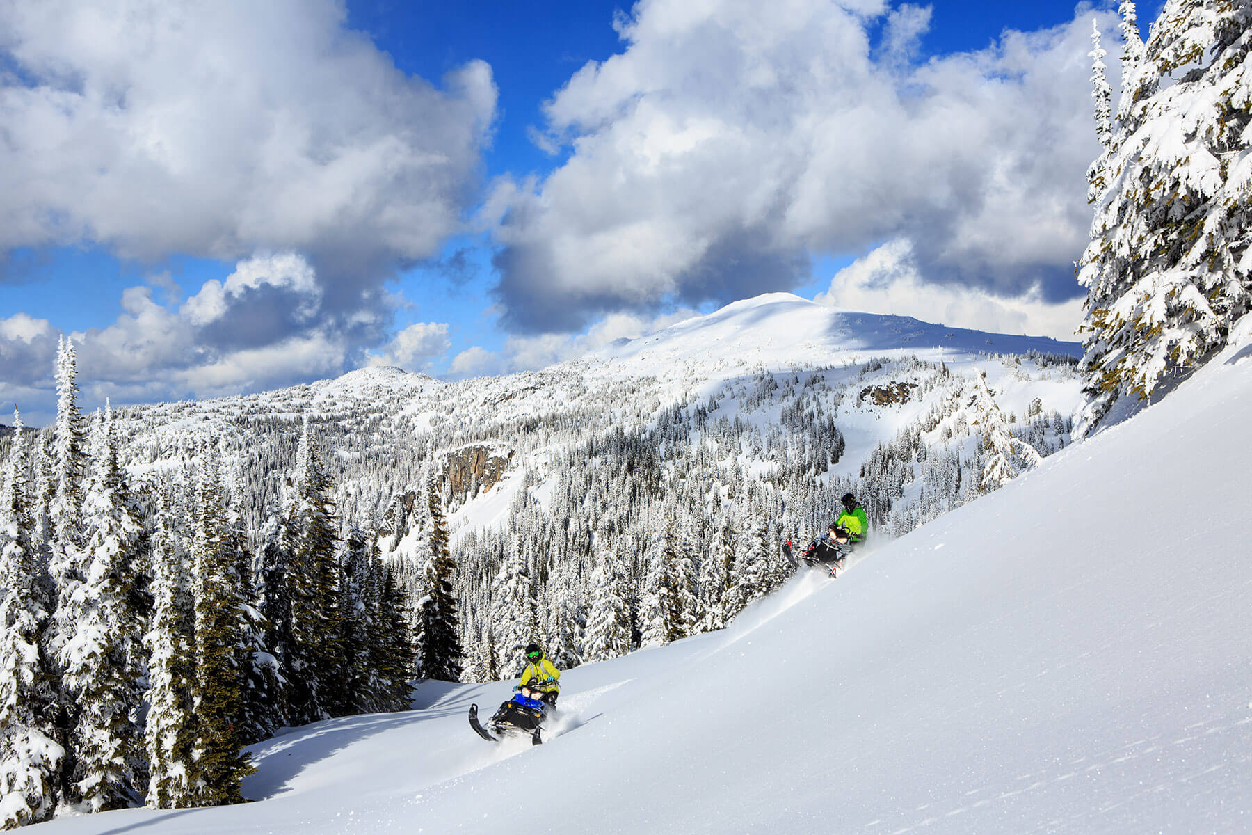 Sidehill-snowmobiling-Grizzly-Lodge